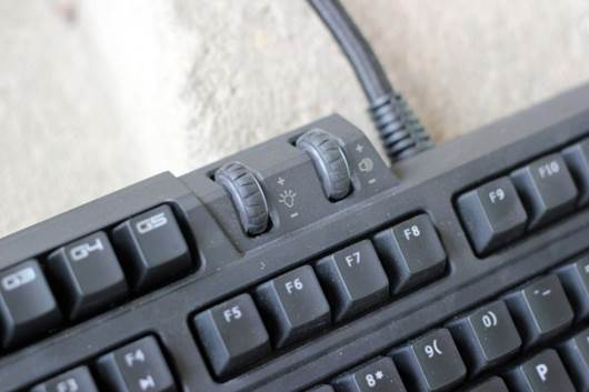 These two wheels are located directly to the right of the macro keys.