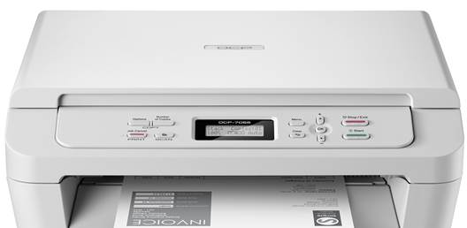 This Brother DCP7055W has a flatbed scanner with a cover, plus a control panel with LCD display and function buttons.