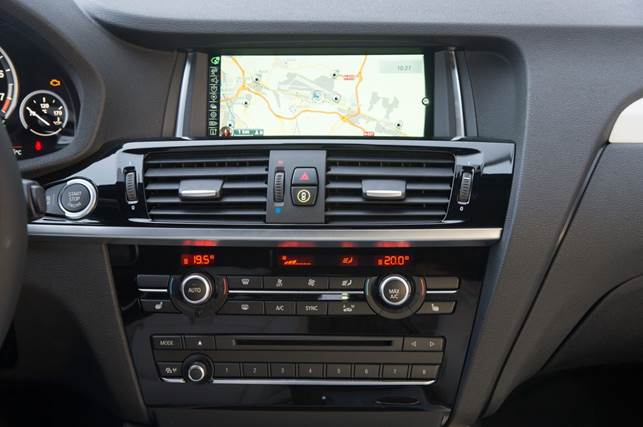 When equipped with the optional nav system, the iDrive Controller comes with a touchpad, which allows front-seat occupants to use their finger to write letters for text inputs, such as a navigation destination