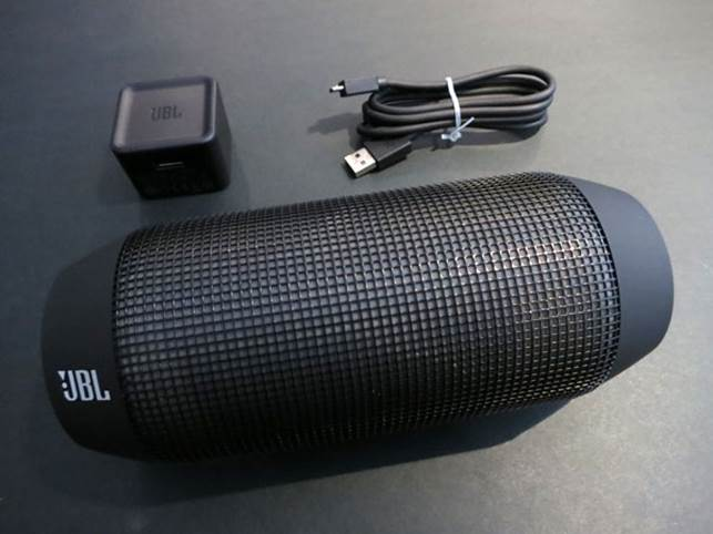 The rubber strip on the length of the speaker contains the micro-USB charging port and the 3.5mm audio jack