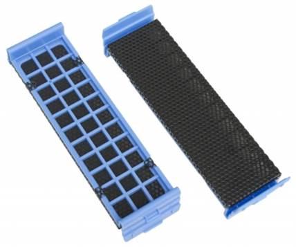 A foam rubber plate behind metal grid helps to shield dust