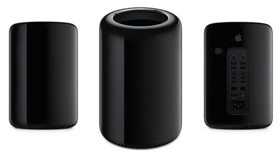 The Mac Pro is cylindrical and a dark, dark grey or black. In volume it's one-eighth smaller than previously. The real beauty of this is its spinning base