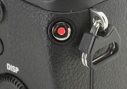 Description: The movie record button of the NEX-6 is placed concavely, somewhat awkwardly, along the right edge of the camera at a 45 degree angle. While requiring a hold of the camera with both hands, its position prevents wrong operation, which is a serious problem towards the NEX-7.