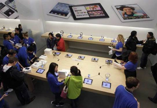 Description: Customers talk with Apple employees